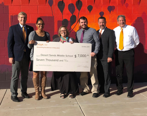 Desert Sands Middle School in Phoenix Arizona is awarded a grant for $7,000 as the third place winner of Voya's Unsung Heroes program. Voya Financial's Jay Jorgensen, senior vice president, Tax Exempt Markets, (pictured on left) presented the check to the school. (Photo: Business Wire)