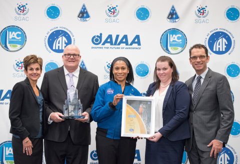 Sarah Willis, Victor Alfano, Emily Turner, and Bruce Burger accept NASA's Space Flight Awareness Award from Astronaut Jeanette Epps. (Photo: Business Wire)