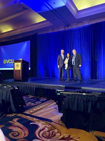 Spok's President and CEO, Vincent D. Kelly awards VCU Health's Don Smith and Stacy White Spok's 2019 Innovation Award. (Photo: Spok)