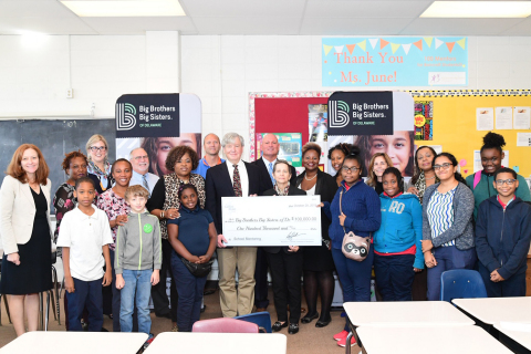 Raymond J. Quinlan, chairman and CEO of Sallie Mae, and Mary P. Fox, executive director of Big Brothers Big Sisters of Delaware, are joined by community leaders, staff, and students to celebrate Sallie Mae's grant of $100,000 to support Big Brothers Big Sisters of Delaware's school-based mentoring programs. (Photo: Glazier Photography)