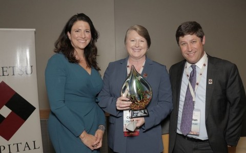 Caitlin Cameron, CEO of OtoNexus Medical Technologies accepts the Most Valued Company award from Keiretsu Forum Northwest Chairman Nathan McDonald. Pictured left to right are: Brianna McDonald, Keiretsu Forum Northwest President; Caitlin Cameron and Nathan McDonald.(Photo: Business Wire)