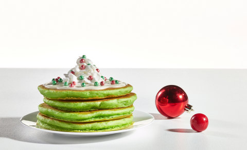 Guests of all ages will delight in ordering a stack (or two) of Jolly Cakes, fluffy green pancakes topped with sweet cream cheese icing, whipped topping and shimmery elf sprinkles that resemble elf-sized ornaments. (Photo: Business Wire)