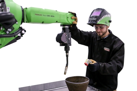 FANUC's new welding cobot works safely alongside people without the need for expensive guarding. (Photo: Business Wire)