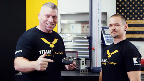 From Left: Titan Gilroy, CEO, Titans of CNC is pictured in his workshop holding a Mitutoyo High Accuracy Micrometer with Travis Jarrett, Quality Manager, Titans of CNC to announce Mitutoyo's new partnership with Titans of CNC. (Photo: Business Wire)