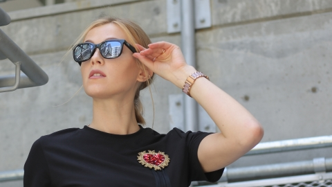 NORM GLASSES: young woman in black shirt, modeling Norm Glasses, by Human Capable Inc. (Photo: Business Wire)