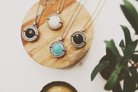 Featuring hand-cut resin accent stones and a highly discreet alert button — these demi-fine jewelry pendants offer the same dependable emergency services seniors have grown to trust — all with an upgraded appearance. (Photo: Business Wire)