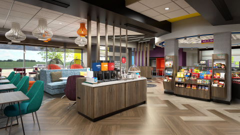 """With areas to work, play games, eat or lounge, Tru by Hilton's spacious lobbies feature a pool table and board games, complimentary Lavazza coffee and the 24/7 """"Eat. & Sip."""" market offering local, gourmet snacks and drinks. Credit: Tru by Hilton"""