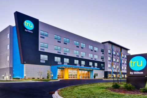 Tru by Hilton celebrates its milestone 100th hotel opening during Hilton's 100th and most dynamic year. Offering guests a consistent, fun experience at an affordable price, the game-changing brand is celebrating this milestone by giving away 100 hotel stays. Credit: Tru by Hilton