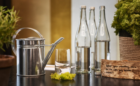 Reusable glass water bottles at Hyatt Regency Amsterdam (Photo: Business Wire)