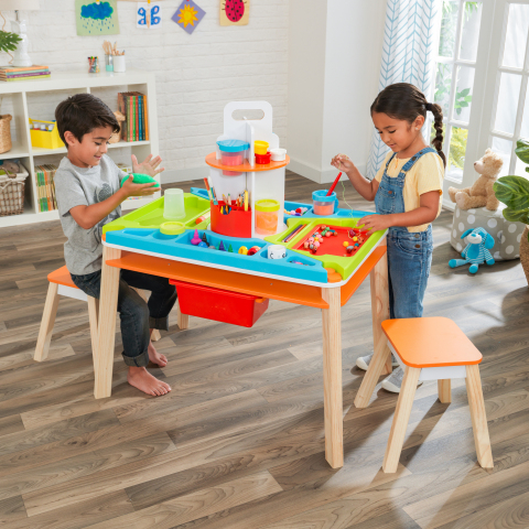 The Ultimate Creation Station from KidKraft - an innovative table set that contains smudges, smears, spots and stickies in one easy-to-access space. (Photo: Business Wire)