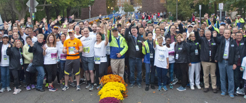 Eversource employees and CEO Jim Judge celebrate this year's Eversource Hartford Marathon. (Photo: Business Wire)