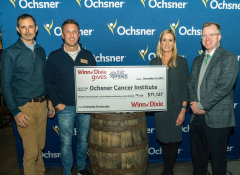 From left to right: Don Noel, President of Port Orleans Brewing Co.; Chip Turner, District Manager at Winn-Dixie; Elizabeth Lapeyre, MD, Director, Integrative Medicine Program for Ochsner; Brian Moore, MD, FACS, Director, Ochsner Cancer Institute (Photo: Business Wire)