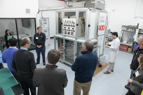 Henkel staff provided tours of the new Technical Center of Excellence focused on flexible packaging applications.  This investment included a laminator and retort chamber for flexible packaging development.  (Photo: Business Wire)