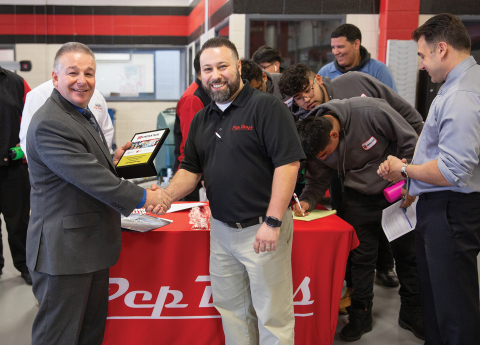 Lincoln Tech's Mahwah Campus President Robert Paganini presents the Chief Executive Officer and President's Pride in Partnership Award to Pep Boys Service Area Director Vinny Lemmo. (Photo: Business Wire)