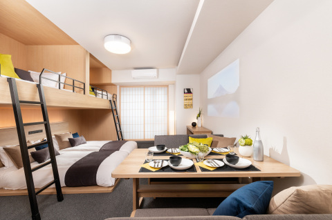 Deluxe Theater Apartment with Loft Beds (Photo: Business Wire)