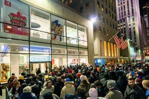 In this photo provided by Nintendo of America, excited fans line up outside the Nintendo NY store as they eagerly await the midnight launch of the Pokémon Sword and Pokémon Shield games, released on Nov. 15, 2019, exclusively for the Nintendo Switch family of systems. (Photo: Business Wire)
