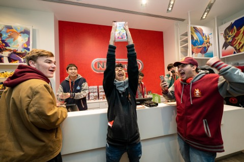 In this photo provided by Nintendo of America, the first few fans to make an in-store purchase of the Pokémon Sword and Pokémon Shield games celebrate at the Nintendo NY store on Nov. 15, 2019. (Photo: Business Wire)