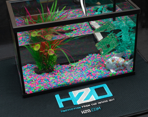 The Company demonstrates an HZO Protected circuit board functioning underwater as one of the hands-on demonstrations at the Open House. (Photo: Business Wire)
