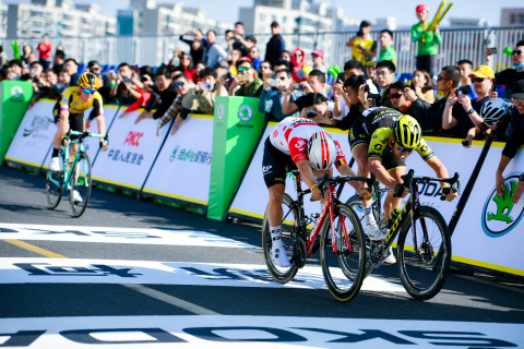 Caleb Ewan (second on the right), champion of 2019 Tour de France Shanghai, ahead of Matteo Trentin (first on the right) at the finish line. Steven Kruijswijk (first on the left) was the 2nd runner up. (Photo: Business Wire)