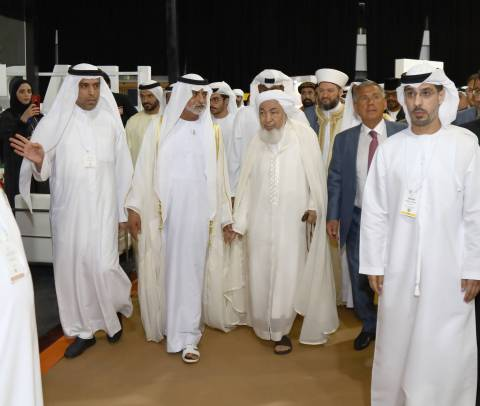HE Sheikh Nahyan bin Mubarak Al Nahyan touring the WTS collocating exhibition, accompanied by Dawood Al Shezawi, Chairman of the Organizing Committee of the WTS (right) and HE Sheikh Abdulla bin Bayyah, Chairman of the UAE Fatwa Council, and HE Rustem Nurgalevich Menekhanov, President of the Republic of Tatarstan (left). (Photo : AETOSWire)