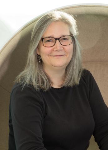 Amy Hennig (Photo: Business Wire)