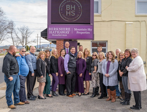 The Berkshire Hathaway HomeServices Mountain Sky Properties team gathers outside its headquarters. (Photo: Business Wire)