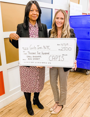 "Coleen Donohue, CAPIS salesperson who created the ""Small Business, Big Impact"" charity initiative, delivered the initial donation to Andrea Brown, VP of Philanthropy at Girls Inc. (Photo: Business Wire)"