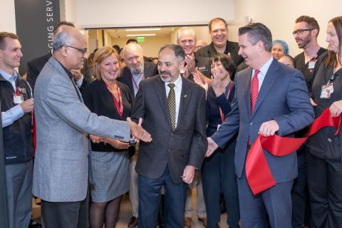 Sridhar Seshadri, Chief Administrative Officer, Destination Service Lines, joins Judith Wood, Administrative Director of Imaging Services, Sam Gambhir, Chair of Radiology, and David Entwistle, President and CEO of Stanford Health Care and members of the Radiology team in cutting the ribbon on the Radiology Department at the new Stanford Hospital. Steve Fisch Photography.