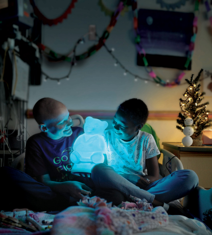 Give today. Show them you care. Light up Dr. Bear. (Photo: Business Wire)