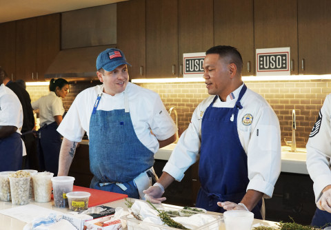 The Blue Apron Culinary team cooks alongside chefs from each branch of the military at the USO Warrior and Family Center at Bethesda on Monday, November 18. (Photo: Business Wire)