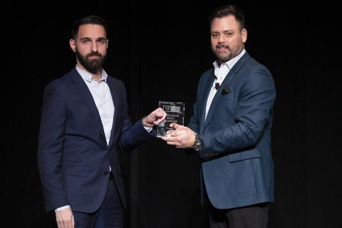 John Hairabedian, president of HGreg.com (left), receives from Keith Crerar, vice president, global operations at TradeRev, the Auto Group of the Year Award in Las Vegas, Nov. 12, 2019. (Photo: Business Wire)