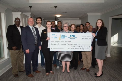 First Federal Bank of Louisiana, First National Bank of Louisiana and FHLB Dallas yesterday awarded a total of $20,000 in grant funds to Project Build a Future in Lake Charles, Louisiana. (Photo: Business Wire)