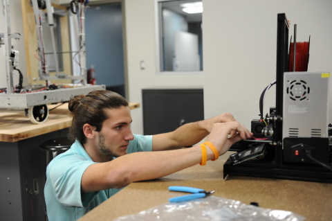 A student works on a 3D printer at the Magnet Innovation Center (Photo: Business Wire)