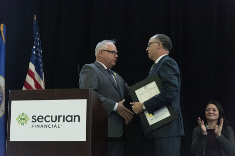 Minnesota Governor Tim Walz presents Securian Financial CEO Chris Hilger an official proclamation honoring Securian Financial as Minnesota's 70th Yellow Ribbon company. (Photo: Business Wire)