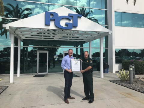 Jeff Jackson with Sarasota County Sheriff Tom Knight (Photo: Business Wire)