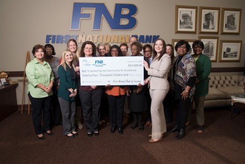 First National Bank of Louisiana and FHLB Dallas awarded $24,000 in Partnership Grant Program funds to Empowering the Community for Excellence, a program that benefits at-risk youth. (Photo: Business Wire)