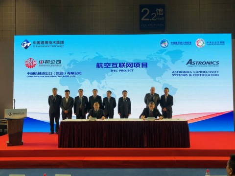 Michael Kuehn (seated at right) of Astronics and Ruan Guang (seated at left) of China National Machinery Import and Export Corporation (CMC) signed a cooperation agreement on November 6, 2019. (Photo: Business Wire)