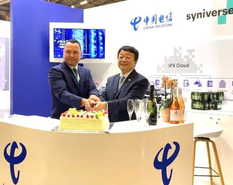 Chris Rivera (left), Chief Technology Officer of Syniverse, and Ou Yan, Executive Vice President of China Telecom Global, celebrate their partnership at AfricaCom 2019. (Photo: Business Wire)