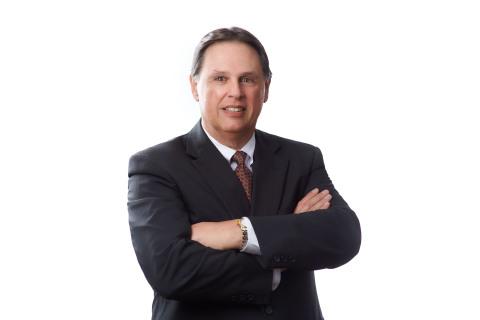 Larry K. Wilcher (Photo: Business Wire)