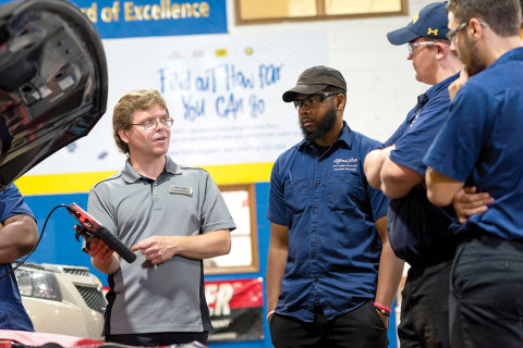 Alfred State College of Technology Instructor Jason Kellogg works with students in a recently rebranded 'Race to 2026' technical training facility at the school. (Photo: Business Wire)