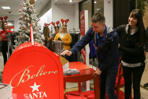 Hank Cazier sends his letter to Santa as part of Macy's Believe campaign, Macy's and Make-A-Wish® celebrate Wish Wednesday each week by granting the wishes of kids battling critical illnesses. Macy's Idaho Falls and Make-A-Wish® celebrated a Wish Wednesday by granting Hank's wish to be a model! (Photo: Business Wire)