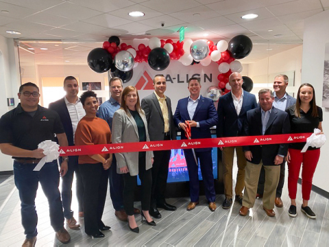 A-LIGN's CEO Scott Price (center) celebrates A-LIGN's 10th anniversary with ribbon cutting ceremony announcing headquarter office expansion and commitment to the local Tampa community. (Photo: Business Wire)