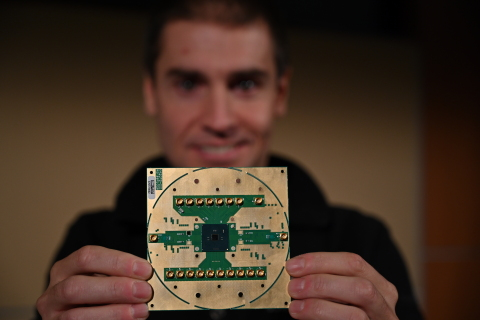 Stefano Pellerano, principal engineer at Intel Labs, holds Horse Ridge. The new cryogenic control chip will speed development of full-stack quantum computing systems, marking a milestone in the development of a commercially viable quantum computer. (Credit: Walden Kirsch/Intel Corporation)