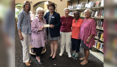 Presentation of a grant for $13,000 for EnChroma glasses for color blindness from the Barbara A. Kay Foundation through the Friends of the Main Library St. Augustine. (Photo: Business Wire)