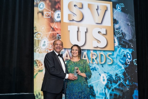 CEO Ragu Bhargava, left, and COO Gita Bhargava accept their awards onstage at the event in San Francisco. (Photo: Business Wire)