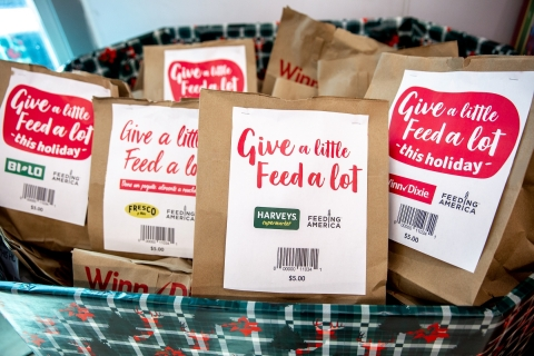 Now through Dec. 24, BI-LO, Fresco y Más, Harveys Supermarket and Winn-Dixie customers can join in the spirit of giving by purchasing a $5 prepared bag of non-perishable food items or by rounding up grocery totals at store registers to spread holiday cheer to local families in need. (Photo: Business Wire)