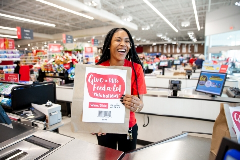 Each donation and $5 holiday bag purchased will be distributed directly to member food banks in the Feeding America® network, the nation's largest domestic hunger-relief organization. (Photo: Business Wire)