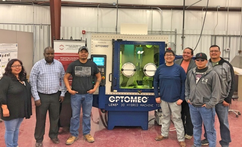 Dr. Monsuru Ramoni, Ph.D., assistant professor of Industrial Engineering at Navajo Technical University and his team of students will be investigating the benefits of Additive Manufacturing for space exploration with the help of Optomec LENS for NASA.Pictured from left to right:Adriane Tenequer, Dr. Monsuru Ramoni,Aaron Sansosie, Calsey Nez, Elliot Burns, Joshua Toddy, Leslie Notah. (Photo: Business Wire)
