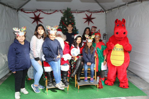 Santa Claus, with some help from Ozzie, handed out presents to more than 1,500 underprivileged children yesterday as part of Orthopaedic Institute for Children's 29th annual Toys & Joy celebration in downtown Los Angeles. (Photo: Business Wire)