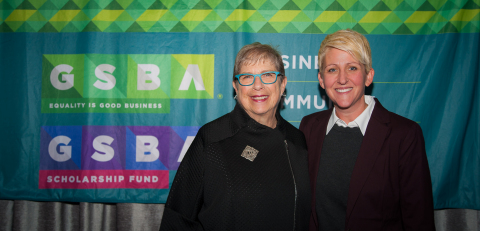 """Symetra has committed $250,000 to the GSBA Scholarship Fund, one of the oldest and most active LGBTQ scholarship programs in the country. """"We're excited about the possibilities that the Symetra grant, the largest multi-year corporate gift in the GSBA Scholarship Fund's history, will offer LGBTQ and allied students,"""" said GSBA CEO Louise Chernin (pictured left). """"Our relationship with the GSBA is grounded in a mutual commitment to promoting diversity, equity and inclusion and our deep respect for the opportunities the GSBA Scholarship Fund provides,"""" said Symetra SVP Trinity Parker (pictured right). The grant """"underlines our long-term commitment to supporting at-risk youth and the LGBTQ community in the Puget Sound region."""" (Photo: Malcolm Smith Photography)"""